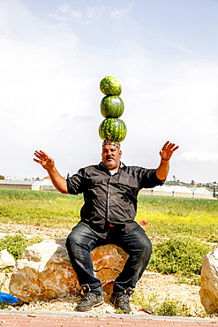 Palestinian selling watermelons at Al-Jalameh checkpoint on Israel-Palestine border, Palestine, Middle East