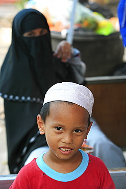 Young Muslim boy and his mother, Kuala Lumpur, Malaysia, Southeast Asia, Asia