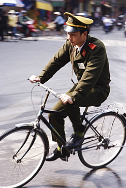 Soldier on bicycle, Hanoi, Vietnam, Indochina, Southeast Asia, Asia