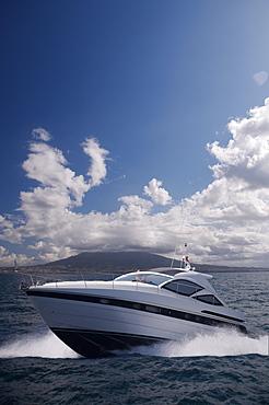 Motor yacht with Mount Vesuvius behind, Bay of Naples, Campania, Italy, Mediterranean, Europe