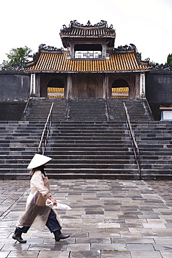 Woman walking past Tu Duc Mausoleum, Hue, Vietnam, Indochina, Southeast Asia, Asia