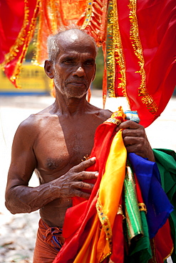 Man with temple decorations and bright fabrics, Kerala, India, Asia