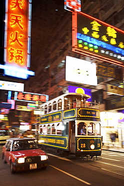 Tram and taxi with neon lights, Hong Kong, China, Asia
