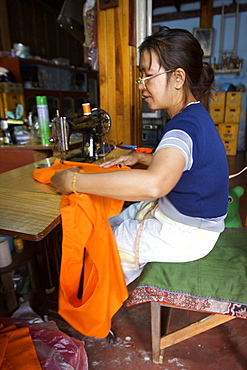 A tailor in the market of Luang Prabang, Laos, Indochina, Southeast Asia, Asia