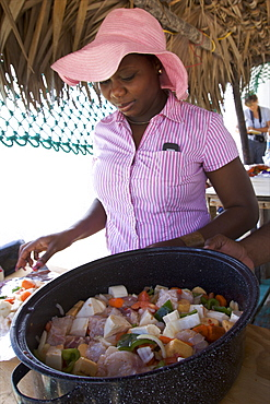 Preparing a classical conch salad from the Bahamas, West Indies, Caribbean, Central America