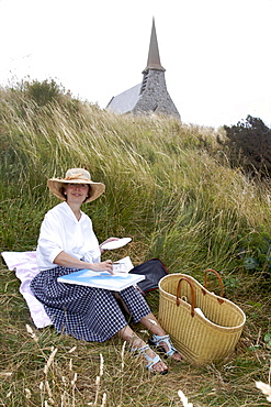 Catherine Jeanne painting the small town of Etretat and the coast, Cote d'Albatre, Seine Maritime, Normandy, France, Europe
