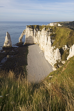 The pebble beach of the Aiguille of Etretat and the cliffs of the Cote d'Albatre, Seine Maritime, Normandy, France, Europe