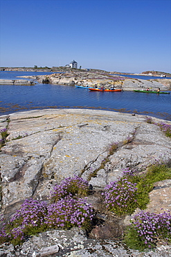 Canoeing along the coast of the Kobba Klintar island in the Aland archipelago, Finland, Scandinavia, Europe