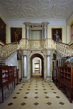 View of the staircase in the Great Hall looking through to the Lobby and Dining Parlour, Audley End, Essex, England, United Kingdom, Europe