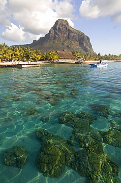 Turquoise water and the Beachcomber Le Paradis five star hotel, with Mont Brabant in the background, Mauritius, Indian Ocean, Africa