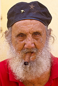 An old man with cap and white beard smoking a cigar, Havana, Cuba, West Indies, Central America