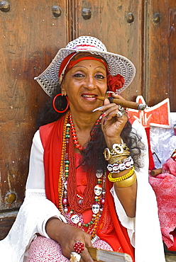 Woman smoking a cigar, Havana, Cuba, West Indies, Caribbean, Central America