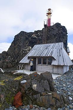 Little chapel and lighthouse at the Henryk Arctowski Polish Antarctic Station, King George Island, South Shetland Islands, Antarctica, Polar Regions
