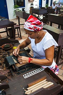 Woman rolling cigars in the Dannemann cigar company in Cachoeira, Bahia, Brazil, South America