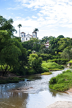 Matrix Church of Our Lady of the Rosary behind a pretty lush landscape in the historic village of Pirenopolis, Goais, Brazil, South America