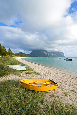 Little boats lying in the grass in front of Mount Lidgbird and Mount Gower in the background, Lord Howe Island, UNESCO World Heritage Site, Australia, Tasman Sea, Pacific