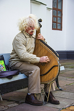 Man playing the traditional Bandura instrument, St. Sophia´s cathedral, Kiev, Ukraine, Europe