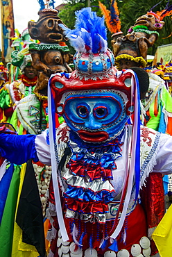 Colourful dressed masked man in the Carneval (Carnival) in Santo Domingo, Dominican Republic, West Indies, Caribbean, Central America