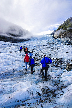 Tourist hiking on Fox Glacier, Westland Tai Poutini National Park, South Island, New Zealand, Pacific