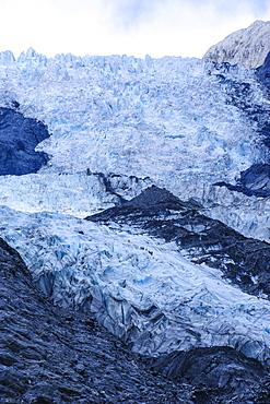 Tourists hiking on the Franz-Joseph Glacier, Westland Tai Poutini National Park, Southern Alps, UNESCO World Heritage Site, South Island, New Zealand, Pacific