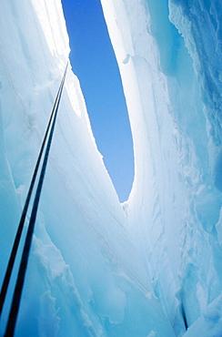 Crevasse in Coleman Glacier, view up climbing rope from below, Mount Baker Wilderness, Washington, USA