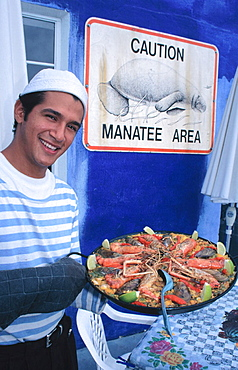 Spanish paella and Caution Manatee sign at Big Fish Mayaimi Restaurant, Little Havana, Miami, Florida, USA