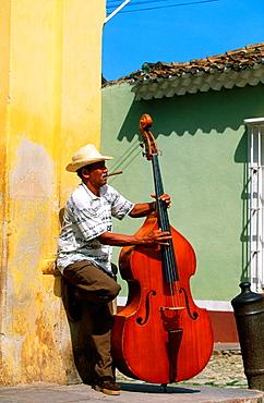 Bass player in a street of Trinidad de Cuba, Cuba