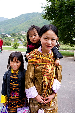 Young girl with sisters, Thimphu, Bhutan