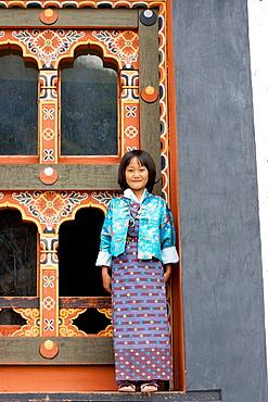 Bhutan, Thimpu, Thimpu Dzong Monastery, Buddhist Festival (Tsechu), Bhutanese little girl