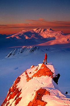 Climber on summit at sunset above Franz Josef Glacier, Westland National Park, New Zealand