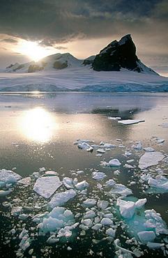 Iceberg and storm clouds, Gerlache Strait, Antarctic Peninsula, Antarctica