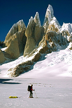 Cerro Torre west face and skier on South Patagonian icecap Los Glaciares National Park Patagonia
