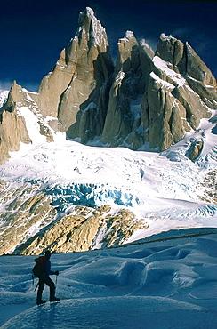 Climber on Torre Glacier under east face of Cerro Torre Los Glaciares National Park Patagonia