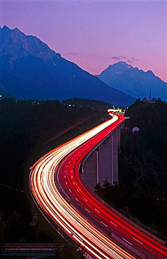 Light tracks at the Europa bridge from traffic as they travel through the Alps along Brenner Pass, Tyrol, Brenner Highway, Austria