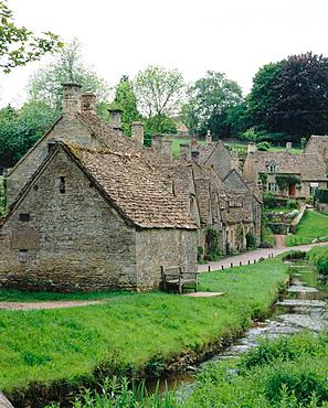 Cottages along Arlington Row in Bibury, The Cotswolds, Gloucestershire, England, UK