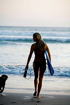 young woman surfer, Santa Teresa beach, Nicoya peninsula, Costa Rica