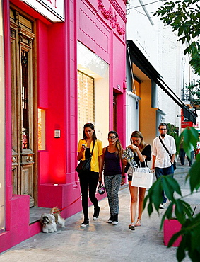 young women walking near plaza Serrano in the trendy area of Palermo Viejo known as Soho Buenos Aires, Argentina