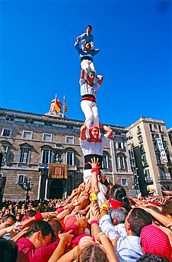 'Castellers' building human towers, a Catalan tradition, Barcelona, Spain