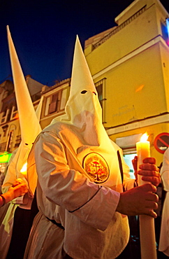 Penitents in Holy Week procession, Seville, Spain