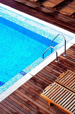 Swimming-pool and chairs at Hotel El Tio Kiko, San Jose, Cabo de Gata, Andalucia, Spain