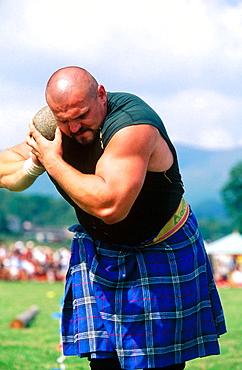 Throwing the weight Highland Games, Callander, Scotland, UK