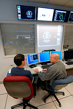 Meteorologists Confer Using Technology in Work Area in National Oceanic and Atmospheric Administration (NOAA), National Weather Service Station, Ruskin, Florida, Tampa, Hillsborough County, Gulf West Central, USA