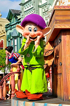 Dopey the Dwarf in parade at Walt Disney Magic Kingdom Theme Park Orlando Florida Central