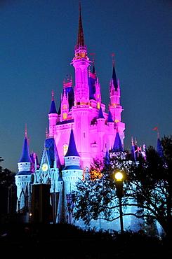 Evening illuminated view of Cinderella Castle at Walt Disney Magic Kingdom Theme Park Orlando Florida Central