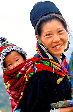 Black Hmong woman with son in Sa Pa outlying area, Vietnam