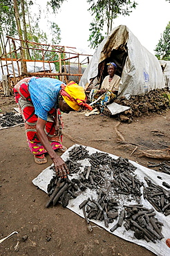Life is going on in the refugee camp Mugunga 1 with a woman selling charcoal, Goma, North Kivu, Democratic Republic of Congo, Africa