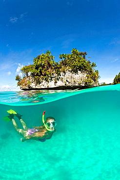 Woman snorkeling in Palau, Micronesia, Palau