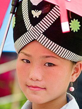 Close up of Hmong girl with traditional dress, Luang Prabang, Laos