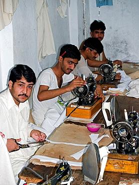 Garment workers in a factory, Peshawar, Pakistan
