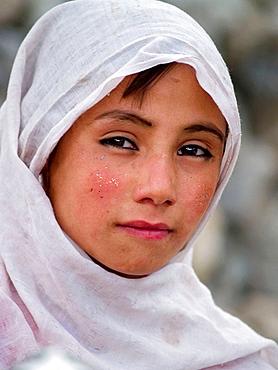 Pakistani girl with headscarf, northern areas, Pakistan
